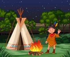 Red indian at the campfire vector