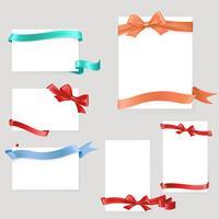 Set di fogli di carta con fiocchi e nastri di raso
