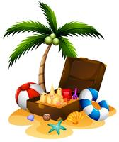 Summer theme with suitcase and sandcastle