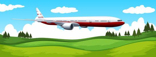 Flugzeug, das über das grüne Feld fliegt