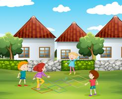 Children playing hopscotch in the yard