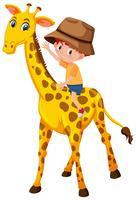 Un ragazzo in sella a una giraffa