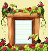 Modello di cornice con tucano e fiori
