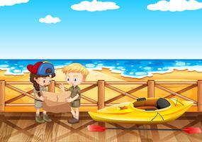 Havsplats med två barn som läser karta