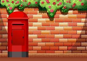 Tegelvägg och postbox