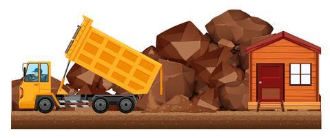 Dumpande lastbil som dumpar jord på byggarbetsplatsen