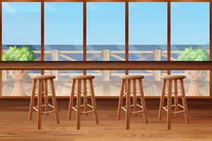 Inside of restaurant with stools and bar