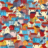 Seamless pattern with bright colorful houses. City or town texture.
