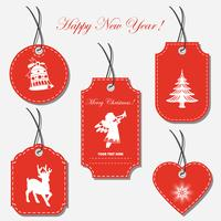 A set of Christmas tags, labels of different shapes. vector
