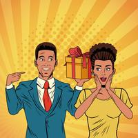 Pop art business couple with present cartoon