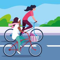 young women riding bike in the road vector