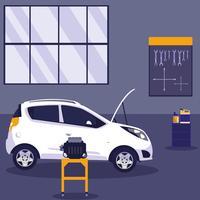 coche blanco en taller de mantenimiento