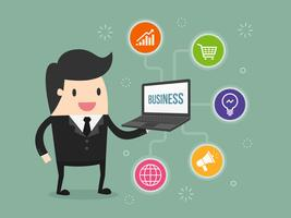 Business man holding laptop with business icons