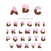 Alphabet with pink cream melted on chocolate.