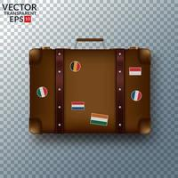 Old vintage leather suitcase with travel stickers