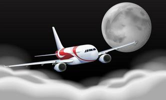 Airplane flying in front of full moon