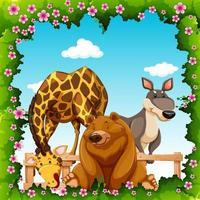 Animales salvajes en marco de flores