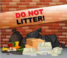 Do not litter sign with trash bags in front of wall