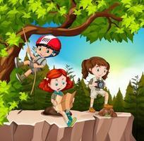 Kids hiking in woods near cliff