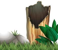 Wooden log and rock on grassland