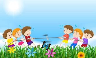 Children playing tug of war in a field