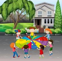 Children playing parachute with balls on the street