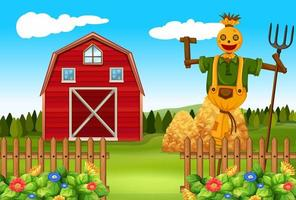 Scarecrow in the farmyard with barn