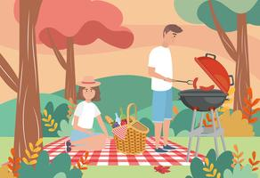 Man and woman having picnic and grilling sausages