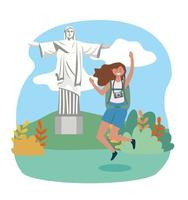 Woman jumping with Christ the Redeemer statue in background