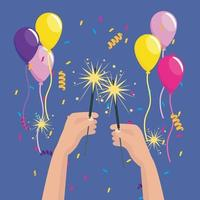 Mani che tengono le stelle filanti con palloncini e coriandoli