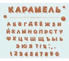 Cyrillic caramel alphabet. Paper cut out sweet letters and numbers.
