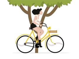 woman riding a bicycle with tree