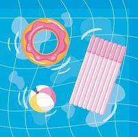 Vue aérienne de la piscine avec flotteur de beignet et radeau