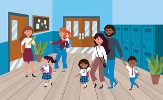 Pais com filhos no corredor da escola