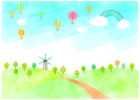 Paisaje con molino de viento y globos de aire caliente
