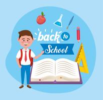 Mannelijke student met terug naar school bericht en benodigdheden