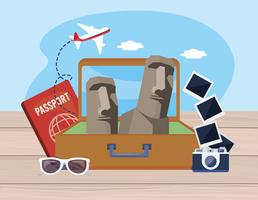Easter island statues in suitcase with passport and camera with photos