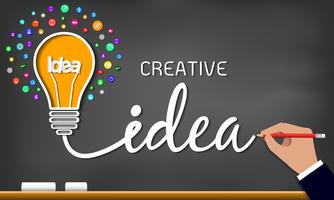 Light bulb and icons. Spark success in business drawing on blackboard background