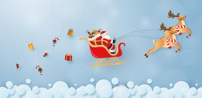 Origami paper art of Santa Claus and reindeer flying in the sky