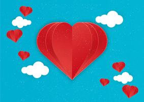 Corazón de papel con nubes