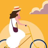 young woman riding bike with sky orange