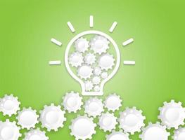 White light bulb and gear wheels on green vector