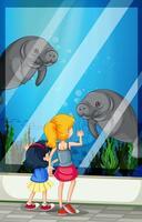 Children looking visiting aquarium