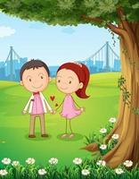Ett par som daterar nära trädet