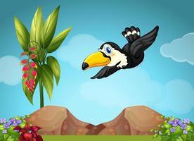 Tucano che vola nel giardino