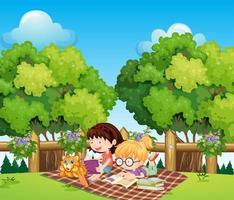 Niños que estudian al aire libre con un gato