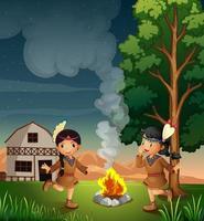 Två små indier med lägereld