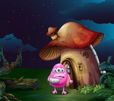 An injured pink monster near the mushroom house vector