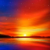 Chaud coucher de soleil sur le lac