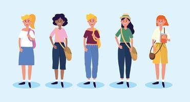 ställa universitetskvinnor med casual kläder och väskor